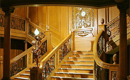 Model of one of Titanic's two grand staircases showing the carving Honour and Glory Crowning Time