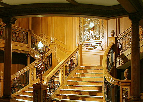 A model of one of Titanic's two grand staircases showing the carving Honour and Glory Crowning Time